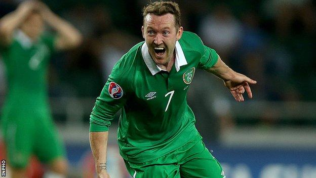 Aiden McGeady turns away in delight after scoring the late winner against Georgia