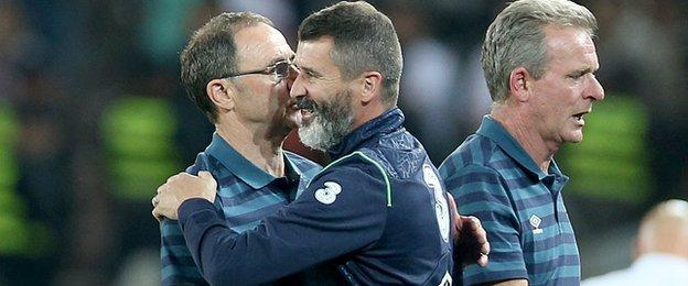 Martin O'Neill is embraced by assistant manager Roy Keane at the final whistle in Tbilisi