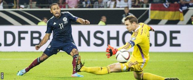 Ikechi Anya scores for Scotland against Germany