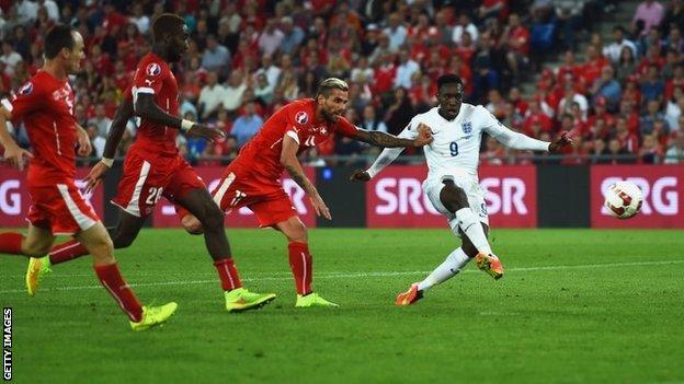 England's Danny Welbeck scores against Switzerland