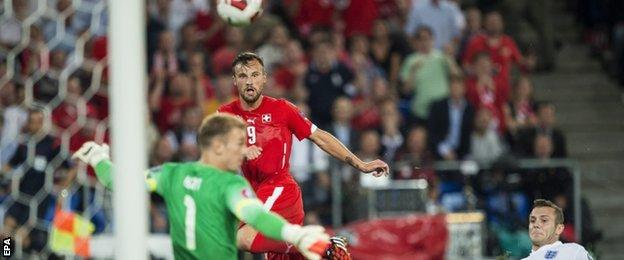 England keeper Joe Hart saves from Haris Seferovic