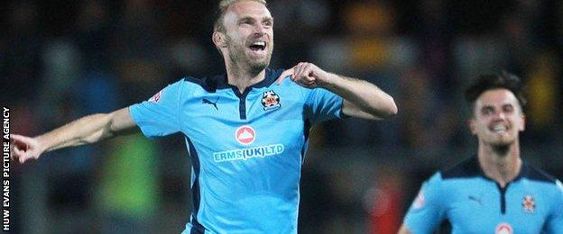 Luke Chadwick celebrates scoring against Newport County