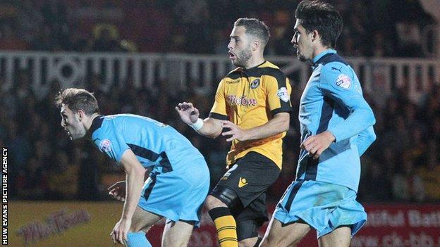 Robbie Willmott scores for Newport against Cambridge