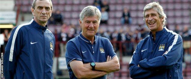 Man City coaches Ruben Cousillas (left) and Brian Kidd (right) with boss Manuel Pellegrini