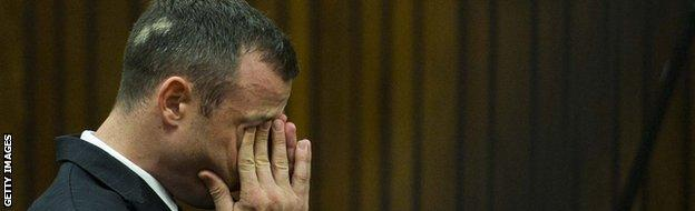 Pistorious wipes tears from his eyes during the trial