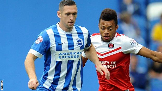 Brighton's Andrew Crofts and Charlton's Jordan Cousins