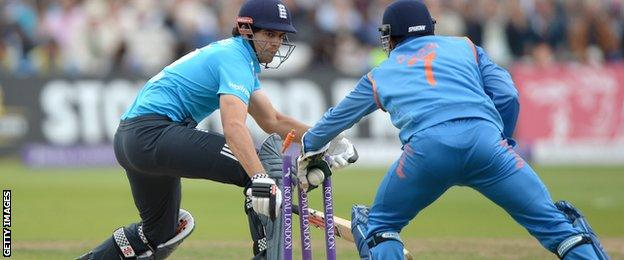 Alastair Cook is stumped by Mahendra Dhoni