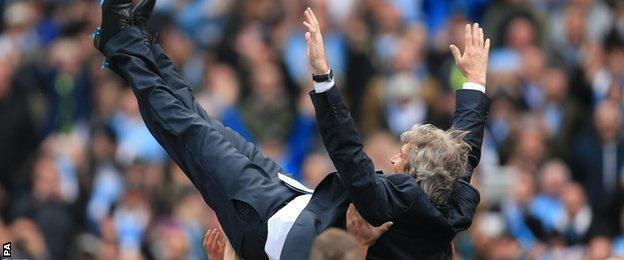 Manuel Pellegrini celebrates winning the Premier League