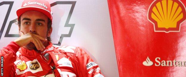 Fernando Alonso of Spain and Ferrari looks on from the team garage during Practice ahead of the F1 Grand Prix of Italy at Autodromo di Monza on September 5, 2014 in Monza.