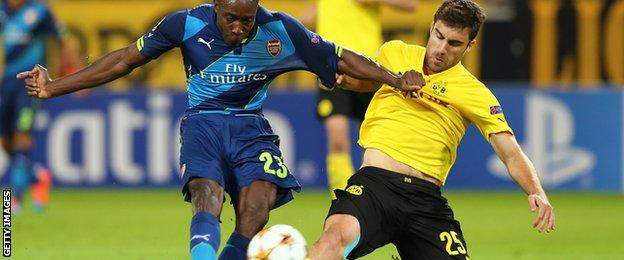 Arsenal's Danny Welbeck attempts a shot in his side's 2-0 Champions League defeat at Borussia Dortund