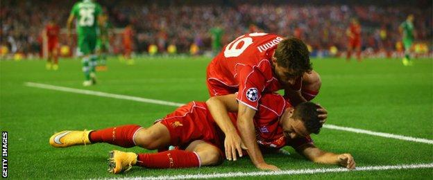 Fabio Borini congratulates Javi Manquillo after he is fouled for Liverpool's late penalty