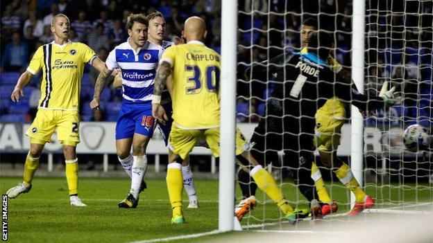 Simon Cox scores Reading's second goal against Millwall