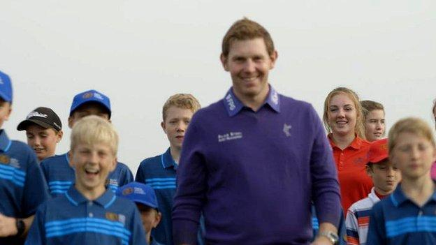 Stephen Gallacher with young golfers