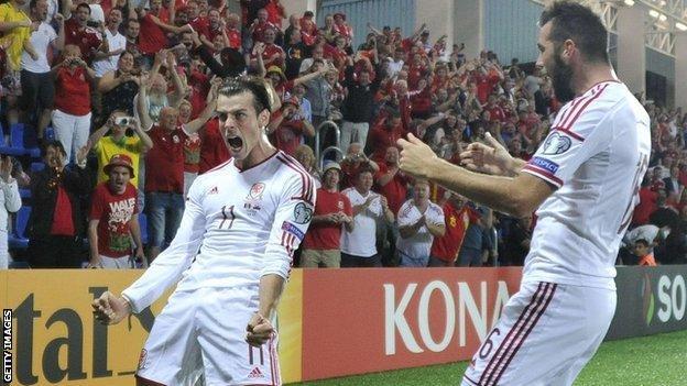 Gareth Bale celebrates with team-mate Joe Ledley after scoring against Andorra