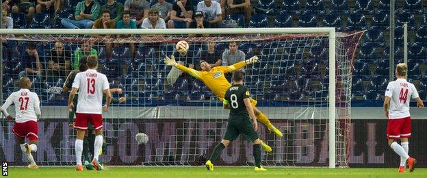 Craig Gordon makes a save for Celtic against Red Bull Salzburg