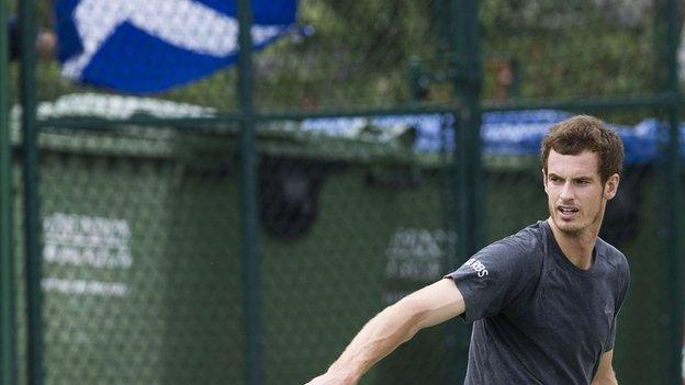 Andy Murray with the Scottish Saltire behind