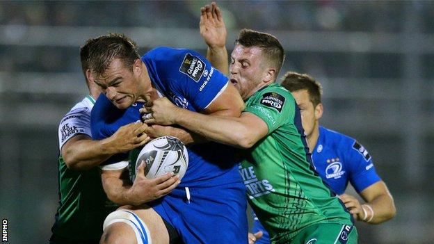 Leinster's Rhys Ruddock is held by Connacht duo Dave Heffernan and Jack Carty
