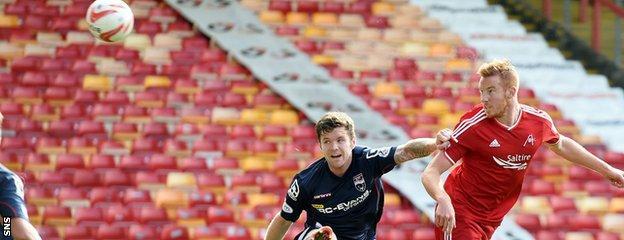 Adam Rooney nets the opener for Aberdeen