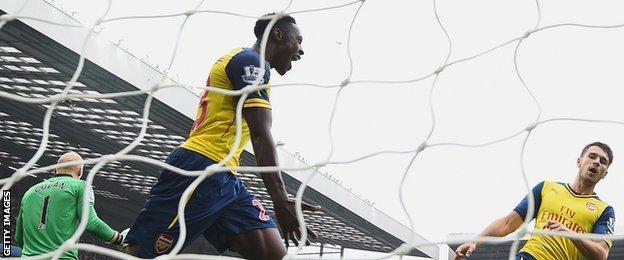 Arsenal striker Danny Welbeck shows his joy after scoring against Aston Villa