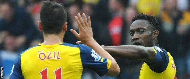 Arsenal duo Mesut Ozil and Danny Welbeck celebrate during the win at Aston Villa