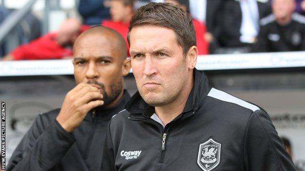 Danny Gabbidon (background) and Scott Young look on as Cardiff tackle Derby
