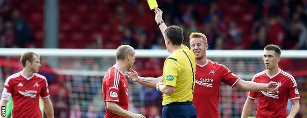 Willo Flood and Ryan Jack are both booked after the Dons pair clashed before half time