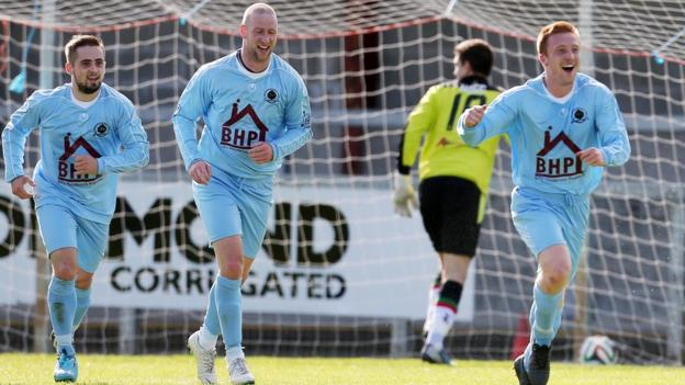 Thomas McBride runs away in celebration after giving Institute the lead against Glentoran at Drumahoe