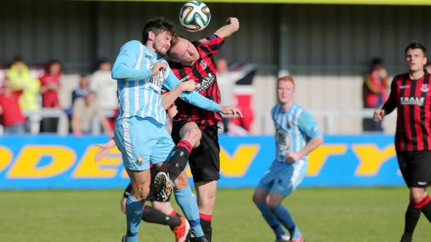 An aerial duel between Ballinamallard's Darren King and Timmy Adamson of Crusaders at Milltown