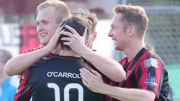 Jordan Owens celebrates with Diarmuid O'Carroll and Timmy Adamson after scoring in the 3-0 win for Crusaders against Warrenpoint