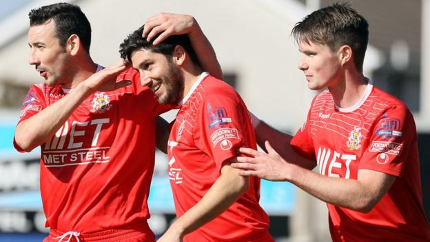 Sean Mackle is congratulated by Portadown team-mates after scoring in the 3-0 win over Ballinamallard United at Shamrock Park
