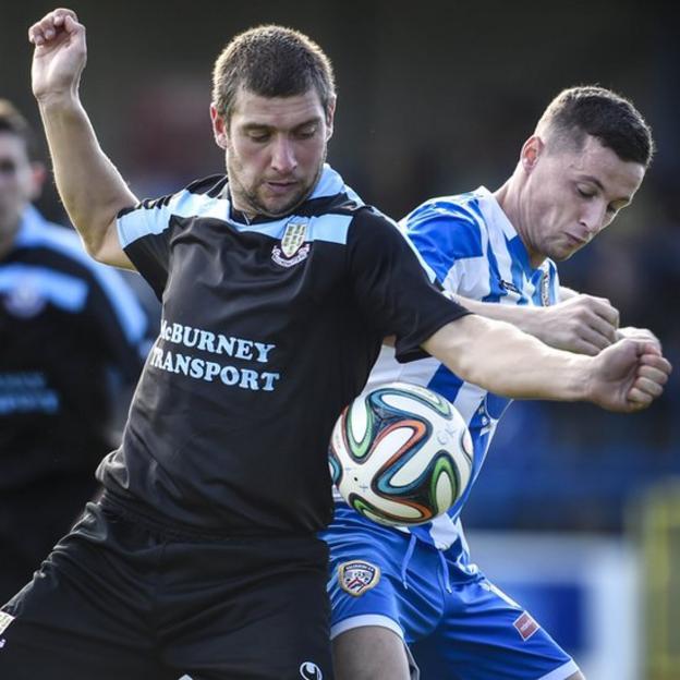 Ballymena United striker Matthew Tipton battles for possession with Ruairi Harkin of Coleraine