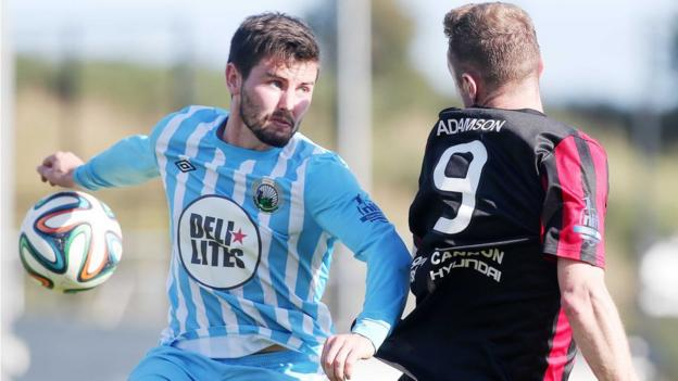 Warrenpoint Town defender Darren King in action against Timmy Adamson of Crusaders at Milltown