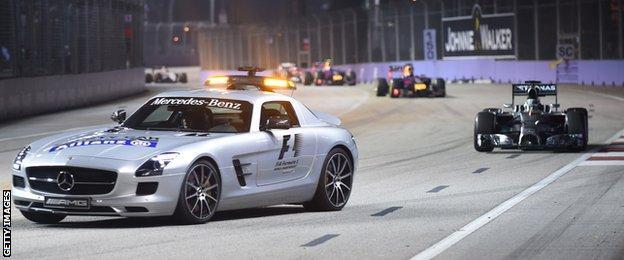 Safety car infront of Lewis Hamilton