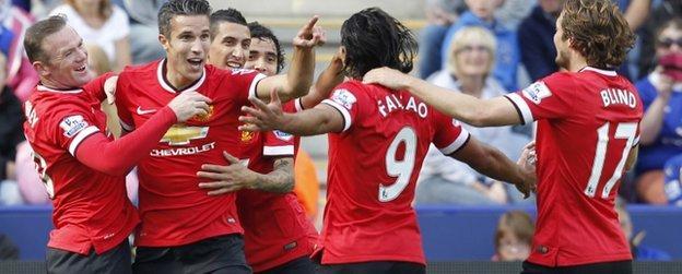 Robin van Persie celebrates with team-mates