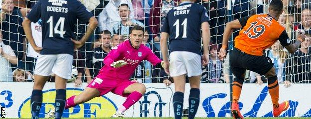 Mario Bilate fires Dundee United into the lead at Dens Park with a first-half penalty