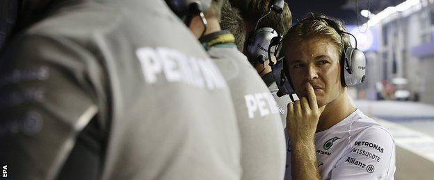 Nico Rosberg watches from pitwall after retiring from Singapore Grand prix