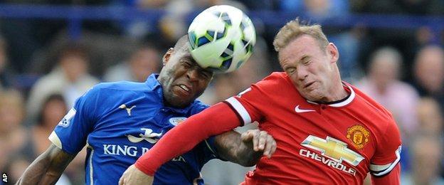 Wes Morgan beats Wayne Rooney to a header