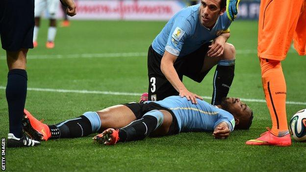 Uruguay's Alvaro Pereira lying unconscious on the pitch at the 2014 World Cup