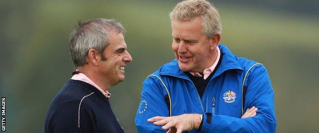 Colin Montgomerie (right) chats with vice captain Paul McGinley during a practice round prior to the 2010 Ryder Cup at the Celtic Manor Resort