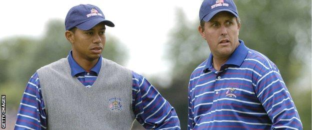 Tiger Woods (left) and Phil Mickelson wait for play during four-ball competition at the 2004 Ryder Cup in Detroit