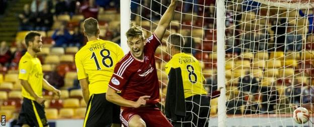 Ashton Taylor celebrates after his first goal for Aberdeen gave them an early lead against Livingston