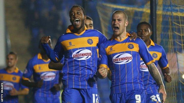 James Collins of Shrewsbury Town celebrates scoring the opening goal with team-mates