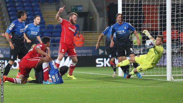 Bournemouth goalkeeper Artur Boruc denies Cardiff City's Tom Adeyemi