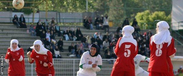 Women footballers wearing hijabs
