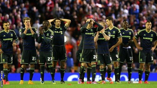 Middlesbrough players after their defeat at Liverpool
