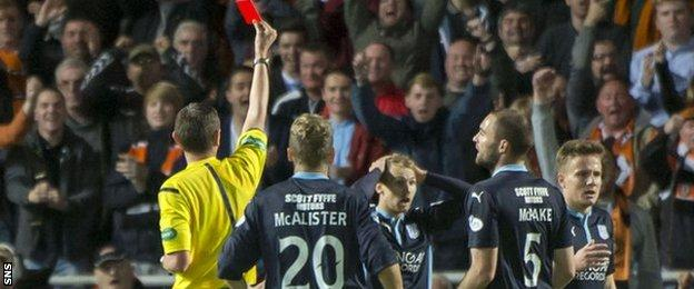 Dundee's Martin Boyle is sent off after fouling Dundee United's Stuart Armstrong