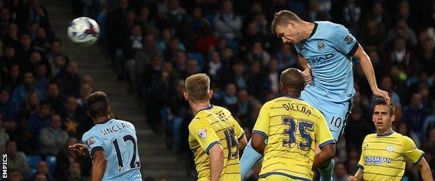 Edin Dzeko scores for Manchester City