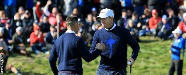 Rickie Fowler and Jimmy Walker celebrate on the final green
