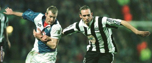 Darren Peacock and Alan Shearer vie for the ball