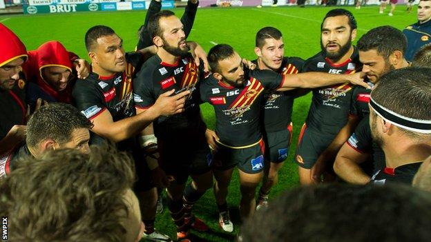 Catalans celebrate victory against Huddersfield.